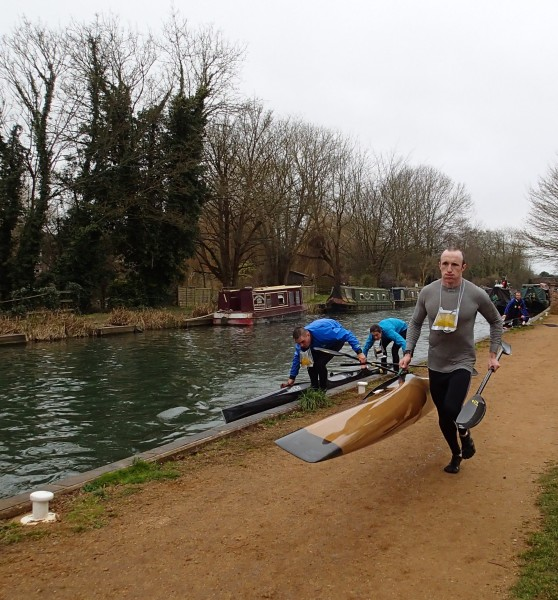 Dan is renowned for his fast portages; here he is out and running before Alex and Radek have picked up their boat!